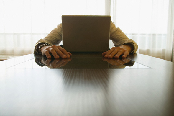 Man Stressed in front of Computer